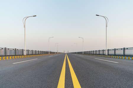 empty asphalt road surface on jiujiang yangtze river bridge