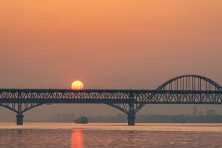 railway and highway combined bridge in sunrise, jiujiang yangtze river bridge closeup, China
