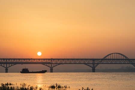 yangtze river landscape of the jiujiang highway and railway combined bridge in sunrise, China Imagens