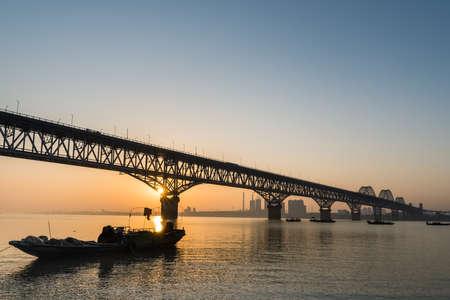 jiujiang highway and railway combined bridge in sunrise, China