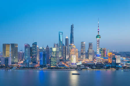charming shanghai skyline in twilight, pudong financial center and huangpu river, China