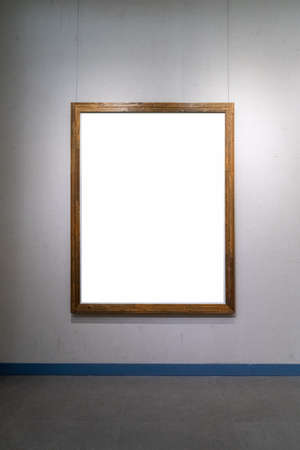 blank wooden picture frame isolated on old wall