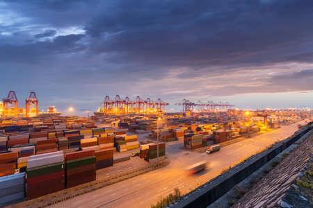 container port in nightfall, shanghai, China Imagens