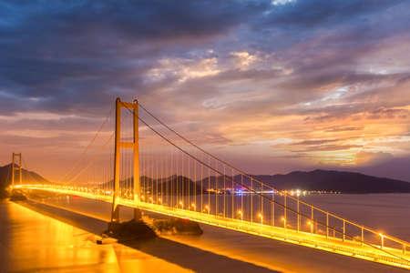 bridge spanning the sea in nightfall, zhoushan city, zhejiang province, China