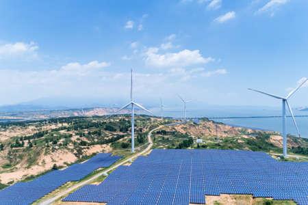new energy by lakeside, wind farm and solar power with sunny sky