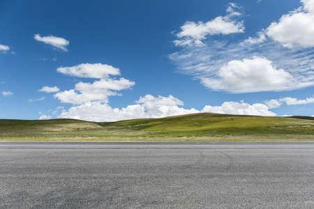 empty asphalt road on the wild against a blue sky
