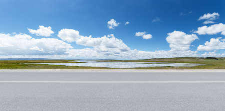 road with sunny sky and beautiful natural landscape, qinghai province, China