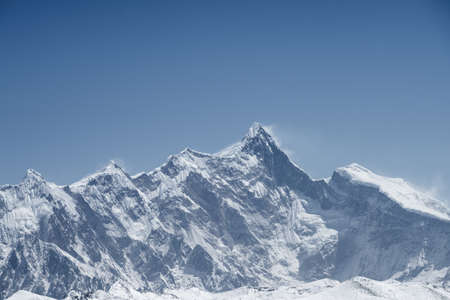 beautiful mountain peaks against a brilliant background of blue sky, tibet, China