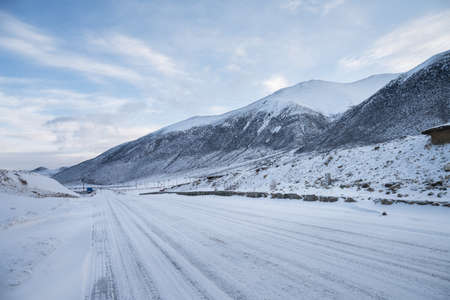 road background on a snowy plateau