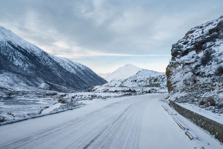 road on snowy plateau, tibet, China