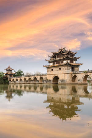 beautiful double dragon bridge at dusk, jianshui ancient city, yunnan province, China