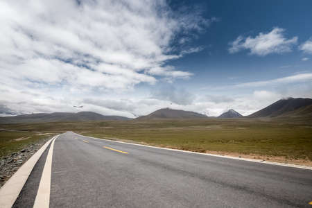 beautiful road on plateau ,long way stretching out into the distance