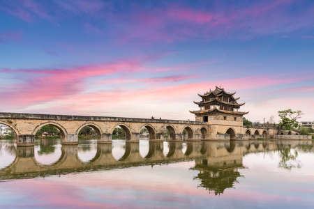 beautiful double dragon bridge in twilight at jianshui ancient city, is one of the famous monuments in yunnan province, China