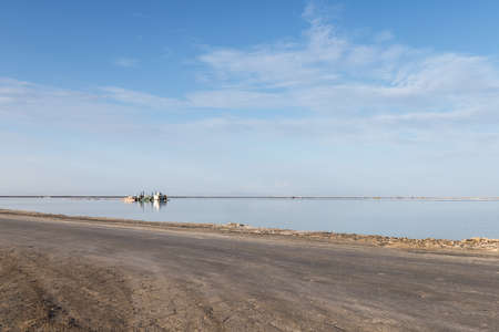 simple road and salt lake industrial landscape, golmud city, qinghai province, China