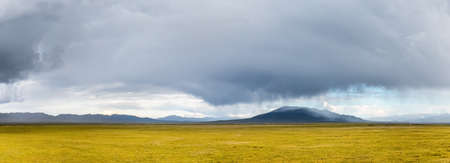 prairie landscape before the storm, panoramic view of autumn pasture in qinghai province, China Imagens