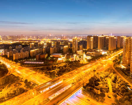qujiang road interchange and skyline at night in ancient city of xian, China