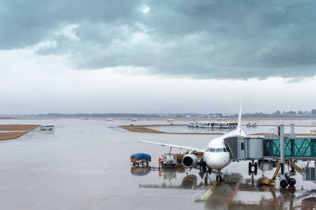 rainy view of the airport, scene outside the terminal with weather Imagens