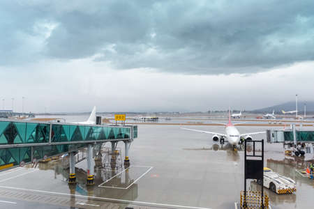 airport in rain, scene outside the terminal with bad weather