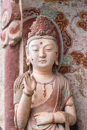 buddhist statue closeup in maiji mountain grottoes in tianshui city, gansu province, China.