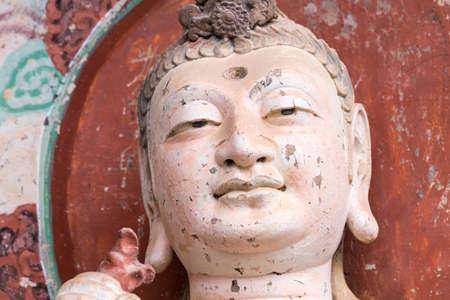 smiling buddha closeup in maiji mountain grottoes, tianshui city, gansu province, China