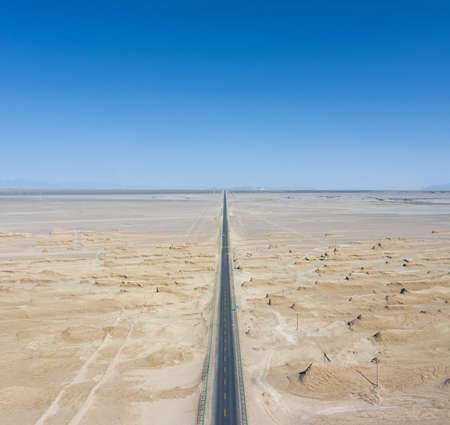 straight road through the wind erosion physiognomy, aerial view of yardang landscape in tsaidam basin, qinghai province, China.