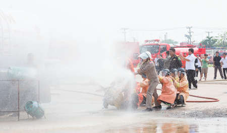 accident fire truck: Kalasin Thailand  MAR 9 : Fire officials are fire drill on march 9 2015 in Kalasin Thailand.