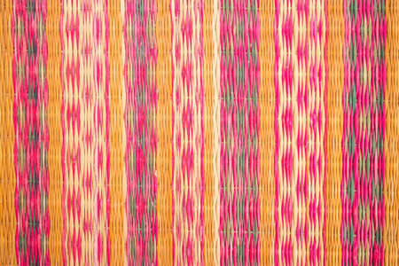 rug weaving: Close up of a straw mat as a background photo. Stock Photo