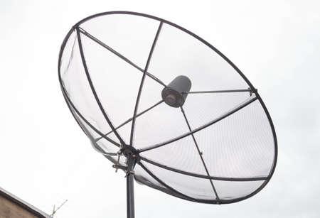 rains: Black satellite dish installed on the roof in the rainy season.
