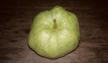 dark: Guava vintage photos on dark wooden floors. Stock Photo