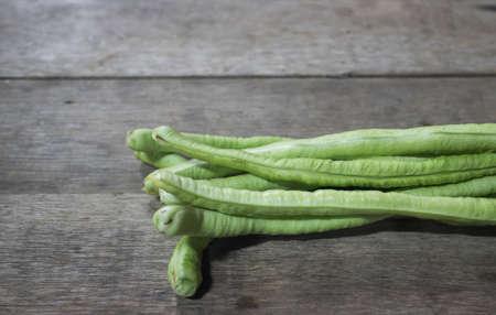 long bean: Yard Long Bean on wooden floor. Stock Photo