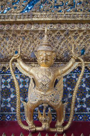garuda: Garuda sculpture at Wat Phra Kaew in Bangkok as a tourist attraction.