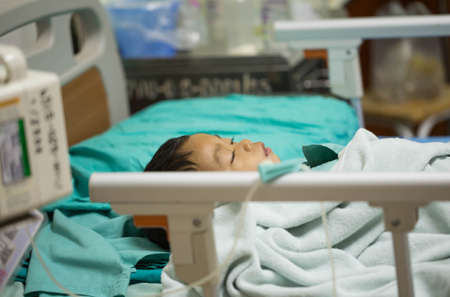 drug control: Pediatric patients lying on the bed. Stock Photo