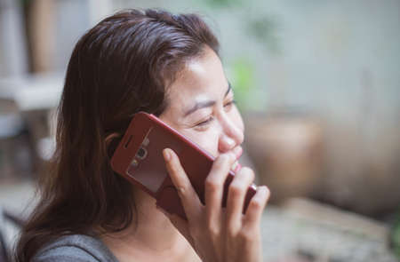 Woman talking on the mobile phone a happy. Stock Photo