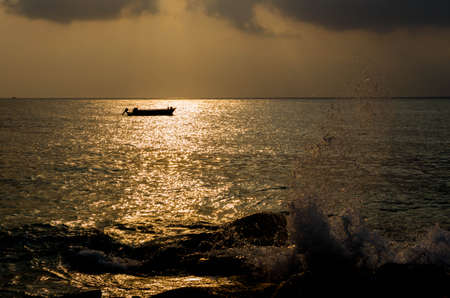 The silhouette of a motor boat on the sea at morning.
