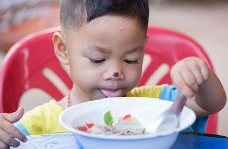 The child eating food yummy.