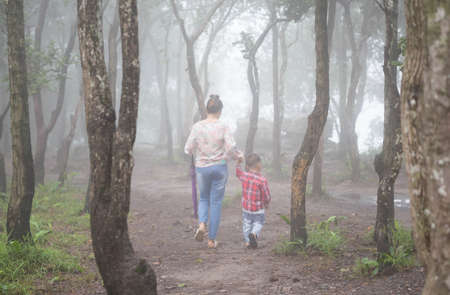 Mother and child in the forest.