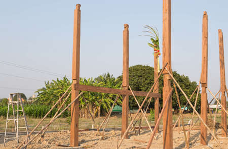 Wooden poles on the earth. 스톡 콘텐츠