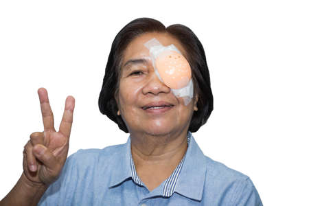 Women wear eye shield because they are pinguecula. 스톡 콘텐츠