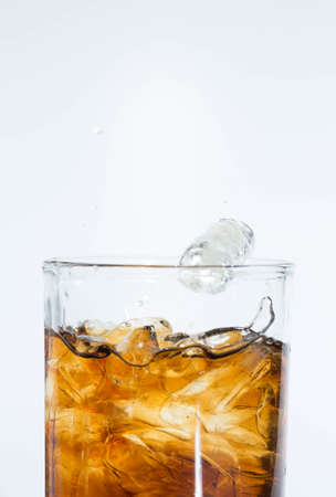Black water in a glass on a white background. Banco de Imagens