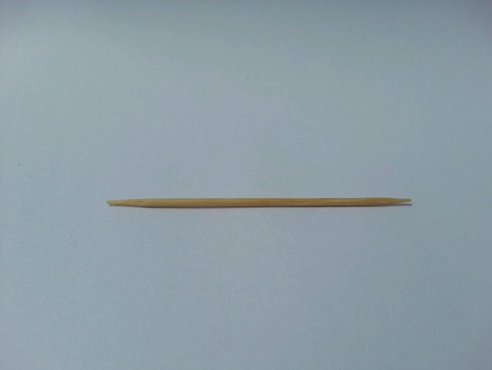 toothpick: One toothpick on white background