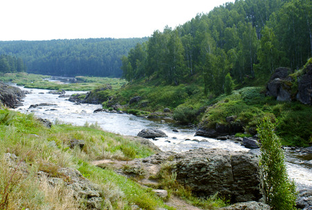 rifts: Rifts on the Ural river Iset. Stormy autumn river. The stone beach, birch forest, yellowed grass.