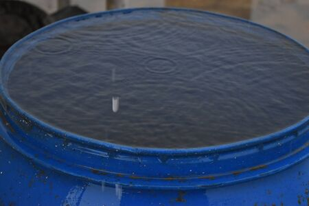 Top view Closeup blue water rings, Circle reflections in drum filled with water