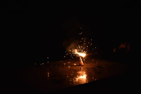 Flower pot Diwali firework tree sparks fire Diwali festival is celebrated in India most popular hindu festival celebrated with fire works. giving fire to the flower pot. Stock Photo