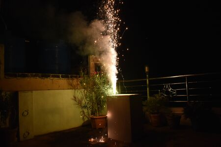 Flower pot Diwali firework tree sparks fire Diwali festival is celebrated in India most popular hindu festival celebrated with fire works. 写真素材