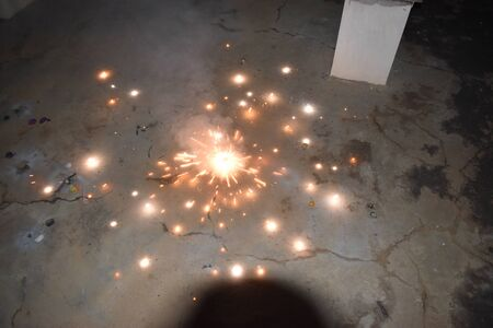 Indian Festival of Lights, A top view of a type of firework cracker known as Chakra or Chakri rotating on the ground, during the Diwali festival celebrations in India
