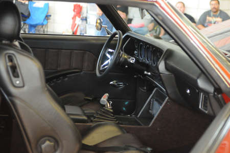 the inside and dashboard of a 1970 Chevelle painted in its origonal colors and racing wheels. It is a two door coupe version.