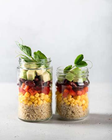 Healthy vegan food concept. Quinoa and fresh vegetable salad in a jar