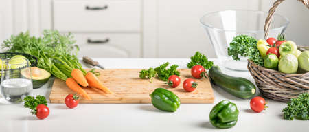 Healthy food concept. Fresh vegetables on a white table on a cutting board in the kitchen. Selective focus Reklamní fotografie - 154076908