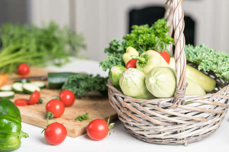Healthy food concept. Fresh vegetables on a white table on a cutting board in the kitchen. Selective focus Reklamní fotografie - 154076923