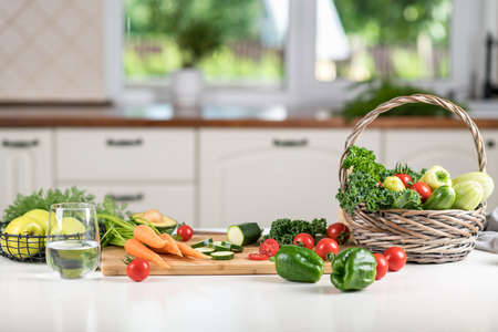 Healthy food concept. Fresh vegetables on a white table on a cutting board in the kitchen. Selective focus Reklamní fotografie - 154076927